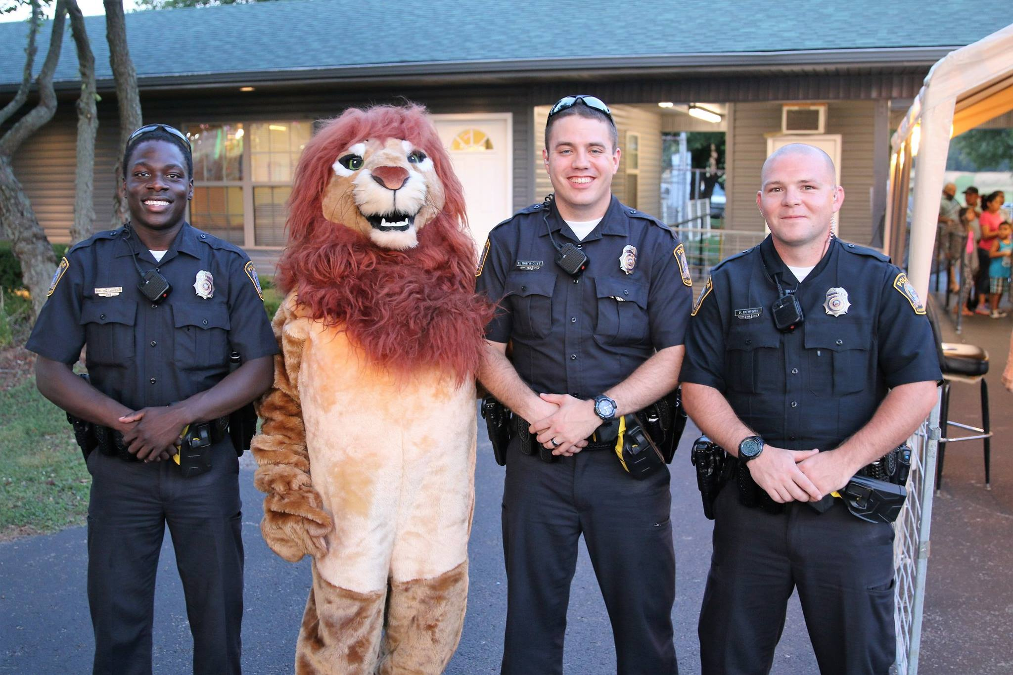 This is supposedly a picture of 4 Lexington Police officers, but I think one of them is lion.